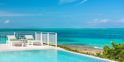 The infinity edge swimming pool of this Turks and Caicos villa rental is the perfect place to cool down and enjoy the shimmering turquoise of Grace Bay.