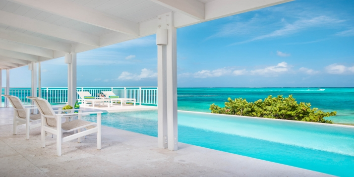 A beautiful beach villa with 4 bedrooms, 4 bathrooms, infinity edge swimming pool and gorgeous views of Grace Bay Beach!