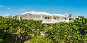Surround by lush, tropical landscaping - Beach Villa Sandstone, Providenciales (Provo), Turks and Caicos Islands.