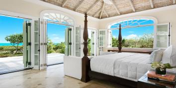 A spacious master bedroom suite at Beach Villa Shambhala, Long Bay Beach, Providenciales (Provo), Turks and Caicos Islands.