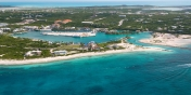 An aerial view all the way from the north to the south of Providenciales in the beautiful by nature Turks and Caicos Islands.