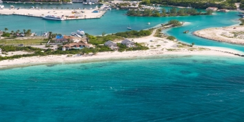 An aerial view of Callaloo Cottage and the Turtle Cove Marina, Providenciales (Provo), Turks and Caicos Islands.