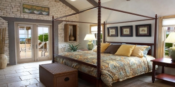 The spacious and tastefully decorated bedroom of Callaloo Cottage, Providenciales (Provo), Turks and Caicos Islands.