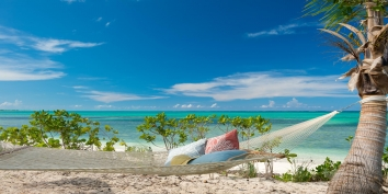 Relax in the beach hammock at villa Castaway, Thompson Cove, Providenciales (Provo), Turks and Caicos Islands.