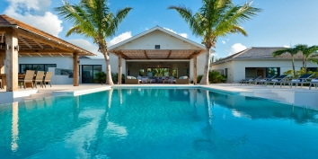The freshwater, infinity edge swimming pool and spacious terrace at villa Castaway, Thompson Cove, Providenciales (Provo), Turks and Caicos Islands.