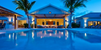 This Turks and Caicos luxury villa rental has a distinct island atmosphere by day or night.
