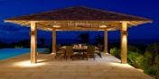This Turks and Caicos luxury villa rental has an outdoor dining table that seats 10 comfortably.
