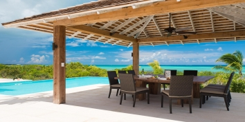 Al fresco dining in the shade at villa Castaway, Thompson Cove, Providenciales (Provo), Turks and Caicos Islands.