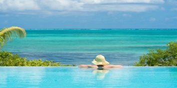 Imagine yourself relaxing in the fresh water, infinity edge swimming pool admiring the countless shades of turquoise.