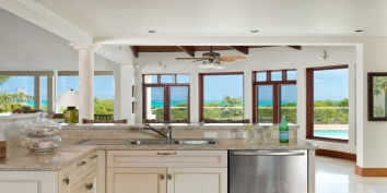 Prepare cocktails or meals while enjoying the stunning views of the turquoise sea at Dawn Beach Villa, Grace Bay Beach, Providenciales (Provo), Turks and Caicos Islands.