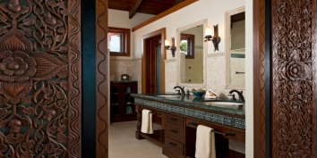 The bathroom of the master suite at Dawn Beach Villa has a gorgeous wooden interior.