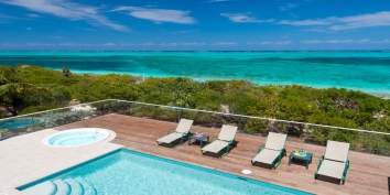 There are stunning views of Grace Bay Beach from the pool deck of Dawn Beach Villa, Providenciales (Provo), Turks and Caicos Islands.