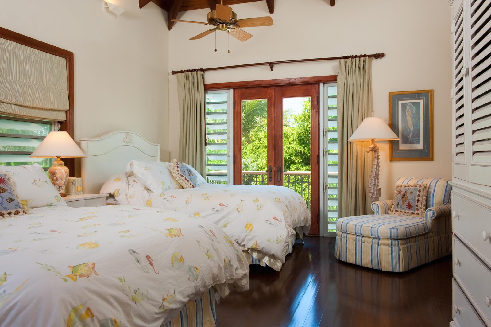 One of the second floor bedrooms has two full beds at Dawn Beach Villa, Grace Bay Beach, Providenciales (Provo), Turks and Caicos Islands.