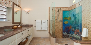 Each of the four main bedrooms features a beautifully decorated en-suite bathroom.