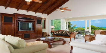 A photograph of the beautifully decorated living room at Dawn Beach Villa, Turks and Caicos villa rental.