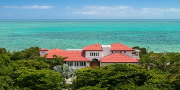 A beautiful and elegant 4+ bedroom beachfront villa with freshwater swimming pool and stunning views of Grace Bay Beach!