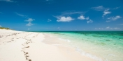 A photograph of the white sand beach in front of Dawn Beach Villa, Grace Bay Beach, Providenciales (Provo), Turks and Caicos Islands.