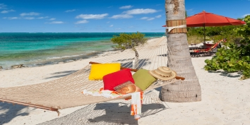 Relax in the beach hammock at Turtle Beach Villa, Grace Bay Beach, Providenciales (Provo), Turks and Caicos Islands.