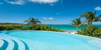 Enjoy gorgeous Caribbean views from this modern, luxury, 5 bedroom, 5 bathroom villa with infinity edge swimming pool and 150 feet of private beachfront!