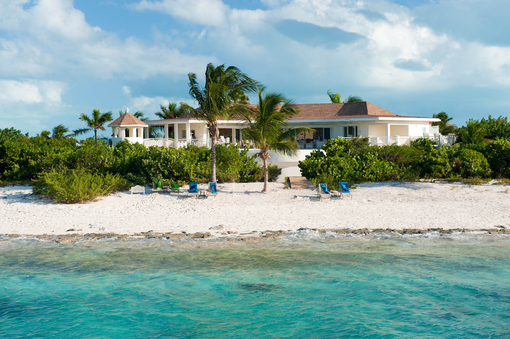 The view of Turtle Beach Villa, Grace Bay Beach, Providenciales (Provo), Turks and Caicos Islands from the sea.