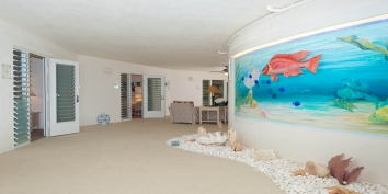 Turtle Beach Villa features a Trompe-l'oeil aquarium wall painting and an extra open-air covered lounge area.