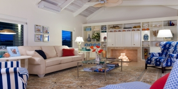 The open concept living room and kitchen at Turtle Beach Villa, Grace Bay Beach, Providenciales (Provo), Turks and Caicos Islands.