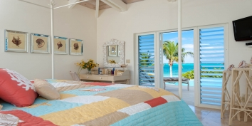 Wake up to the Caribbean breeze in the Seashell bedroom at Turtle Beach Villa, Grace Bay Beach, Providenciales (Provo), Turks and Caicos Islands.
