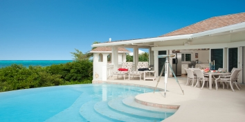 This Caribbean luxury holiday villa features an elevated swimming pool deck with infinity edge swimming pool.