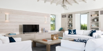 This Turks and Caicos Islands vacation villa rental has plenty of space for sitting and relaxing together.