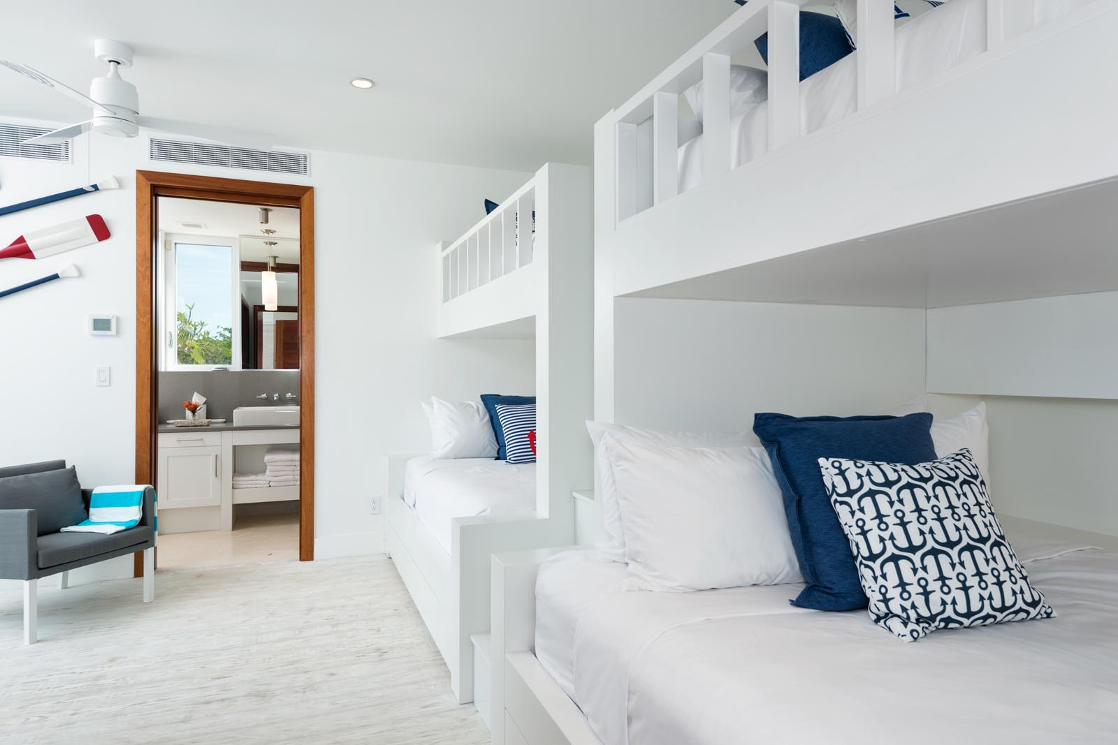 The fifth bedroom suite of Villa Aguaribay features two queen beds and two twin beds.