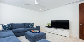 Cool down by watching movies in the Cinema room of this Turks and Caicos villa rental with comfortable seating and a 55″ flat-screen TV.