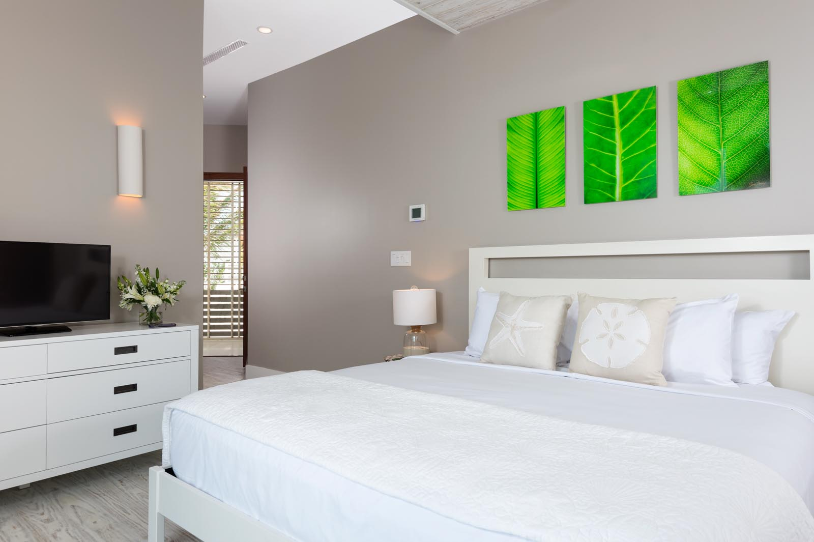 All bedrooms at Aguaribay, Long Bay Beach, Providenciales (Provo), Turks and Caicos Islands feature a 32″ TV.