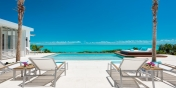 Stunning views over the shimmering turquoise of the Caicos Banks from this Turks and Caicos vacation villa rental.
