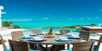This Turks and Caicos Islands villa rental makes outdoor dining a highlight with amazing views of Long Bay Beach.