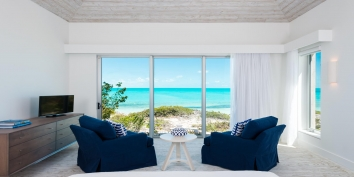 Aguaribay villa has four luxurious master bedroom suites, all with great views of Long Bay Beach.