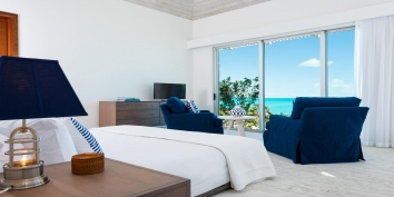 Wake up to the bright Carribbean sunshine at this Turks and Caicos Islands vacation villa rental.