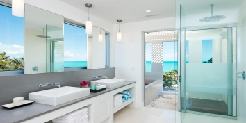 A beautifully designed bathroom at villa Aguaribay, Long Bay Beach, Providenciales (Provo), Turks and Caicos Islands is combined with an outdoor bath and shower.
