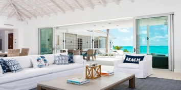 The Great Room of this Turks and Caicos villa rental combines the living, dining, and kitchen areas.