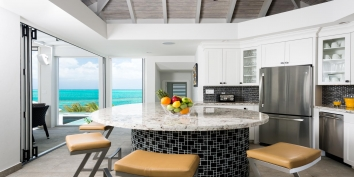 Prepare some delicious cocktails while enjoying the view from the kitchen at this Turks and Caicos villa rental.