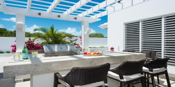 Villa Cascade has a modern chef's kitchen and also an outdoor grill and wet bar.