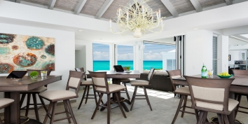 The flexible design of the indoor dining area at Villa Cascade, Providenciales.