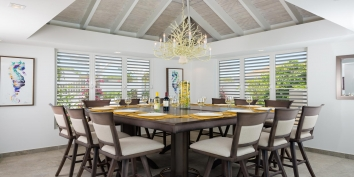Enjoy local cuisine in the comfort of your vacation home, dining indoors or outdoors with ample seating for 12 at this Turks and Caicos villa rental.