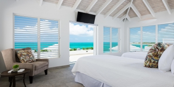 All bedrooms at Villa Cascade, Babalua Beach, feature a flat-screen TV and private ocean views.