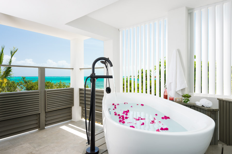 The 2 master bedrooms on the third level at this Turks and Caicos vacation villa rental have outdoor bath tubs.