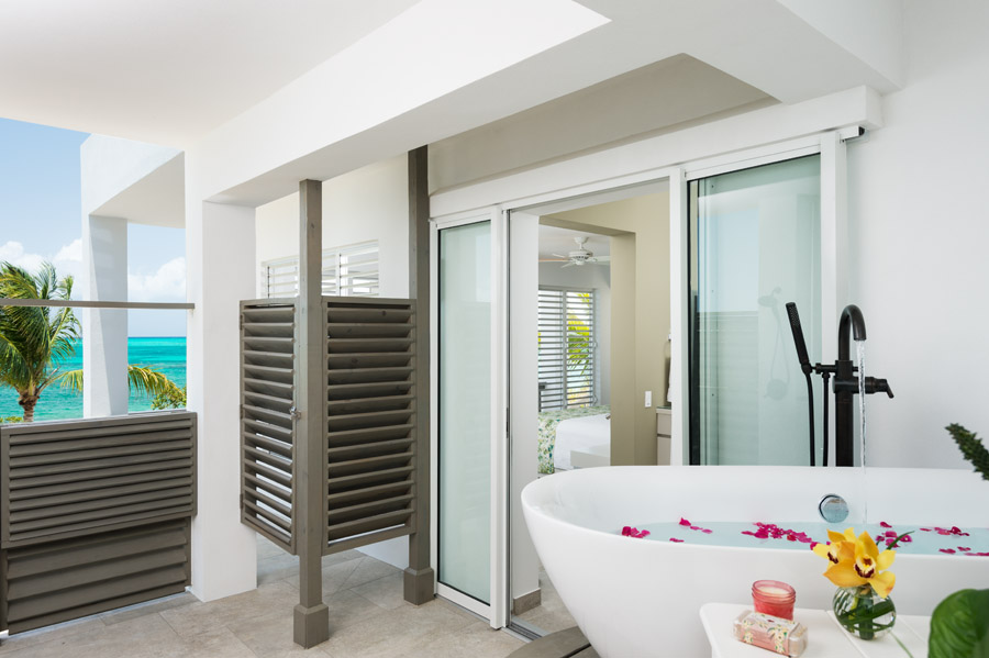 Relax in an outdoor bath tub and enjoy the fresh air and breeze at this luxury Carribbean villa.