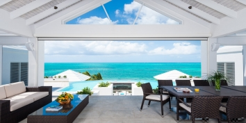 Villa Cascade offers stunning views of the Carribbean horizon from the upper dining area.