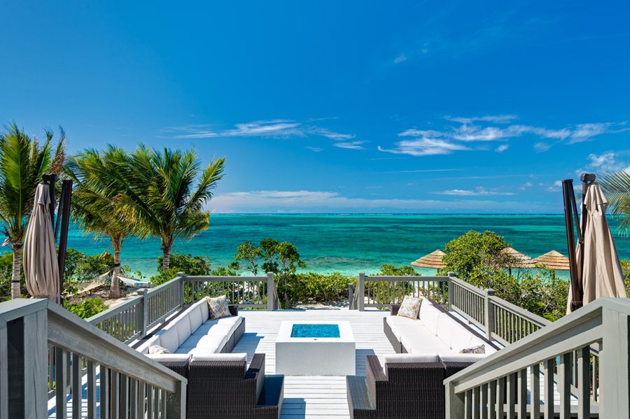 the spacious fire pit deck of this luxury turks and caicos villa rental