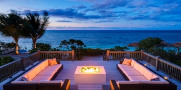 Retire at sunset to the fire pit deck just steps above the white sands of Babalua beach, Providenciales (Provo), Turks and Caicos Islands.