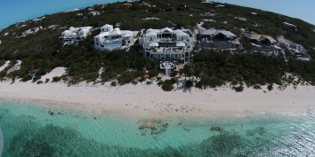 This Turks and Caicos villa rental is located directly on beautiful Babula Beach.