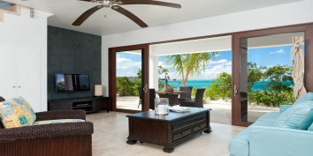 "The comfortable and spacious beach level living room of Sea Edge Villa features a fully equipped 40"" Google TV with web capabilities."